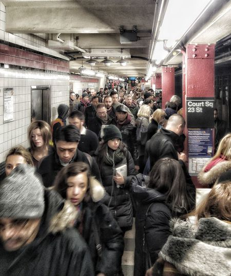 Rush Hour Queens NYManhattan BoundLarge Group Of People Passenger Train - Vehicle Transportation Public Transportation Real People Indoors  Men Women Subway Train People Day Adult Adults Only