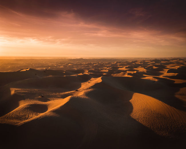Dramatic sky looming of the endless dunes of the desert