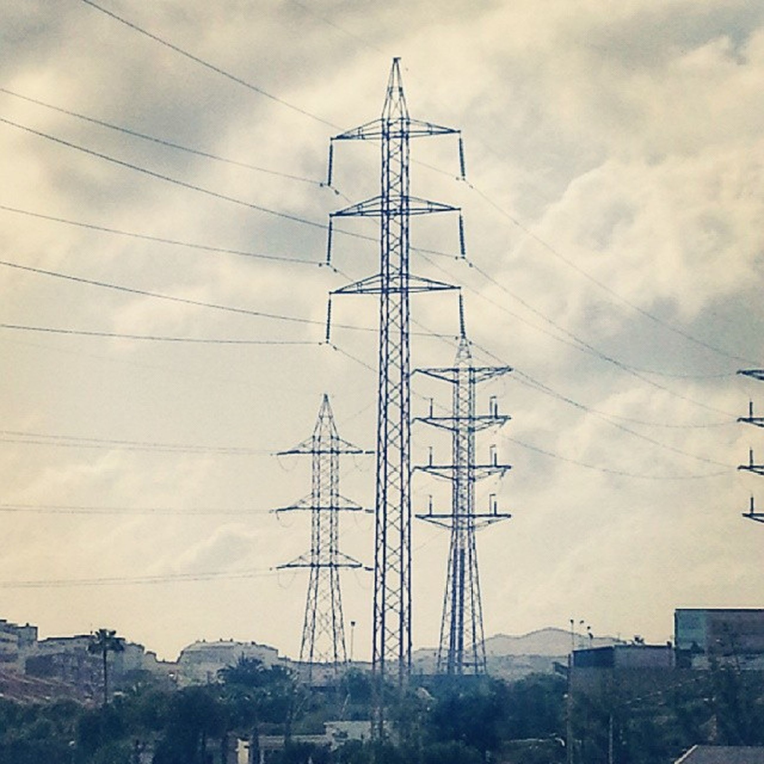 power line, electricity pylon, electricity, power supply, fuel and power generation, technology, cable, connection, sky, cloud - sky, low angle view, built structure, power cable, building exterior, architecture, cloud, cloudy, outdoors, day, no people