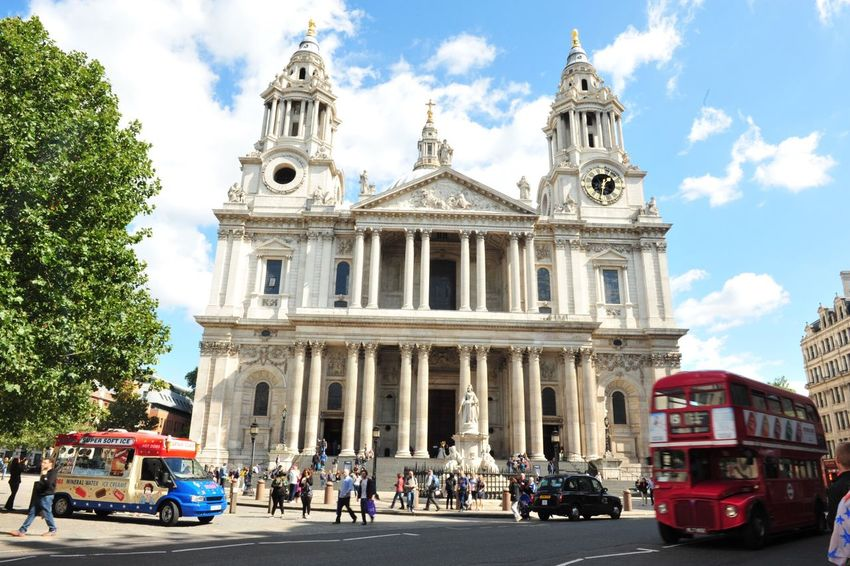 EyeEm LOST IN London Architecture Sky Cloud - Sky Building Exterior Religion Place Of Worship Built Structure Day Architectural Column Outdoors Low Angle View Car Spirituality Façade Sunlight Sculpture Statue Large Group Of People Real People Tree St Paul's Cathedral