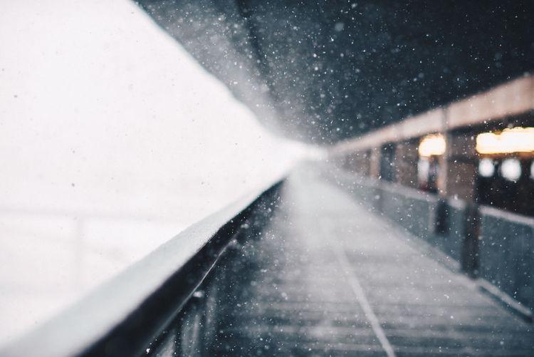 Empty corridor during snowfall