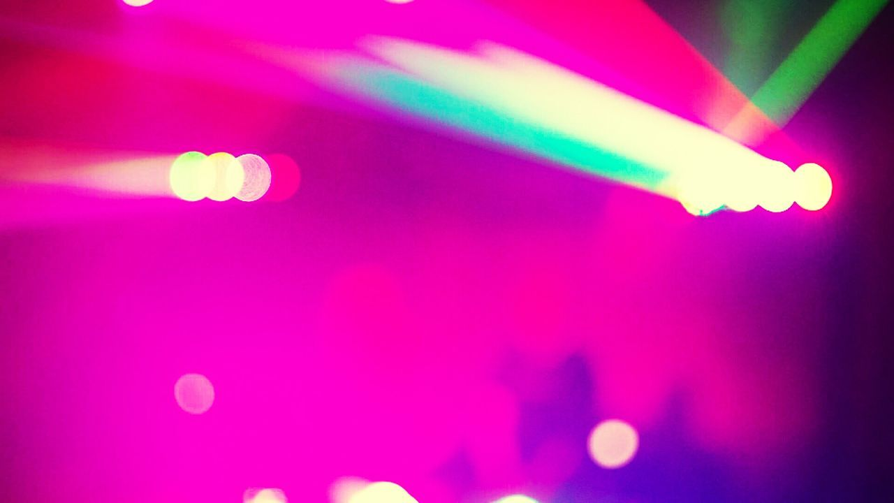 Defocused Image Of Illuminated Lights In Nightclub