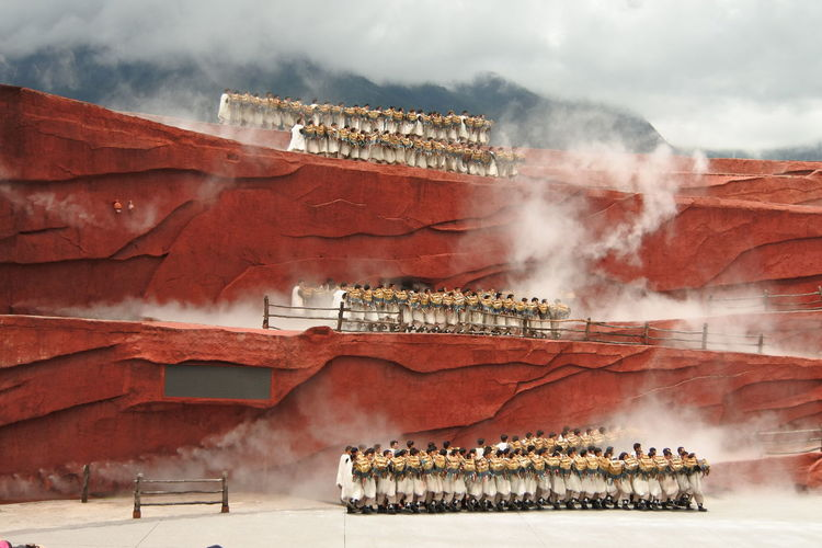 People in traditional clothing on rock formations