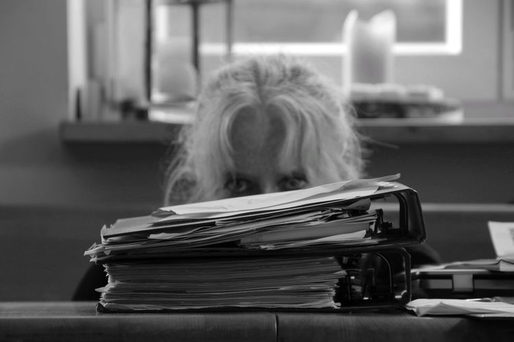 Portrait of woman behind files