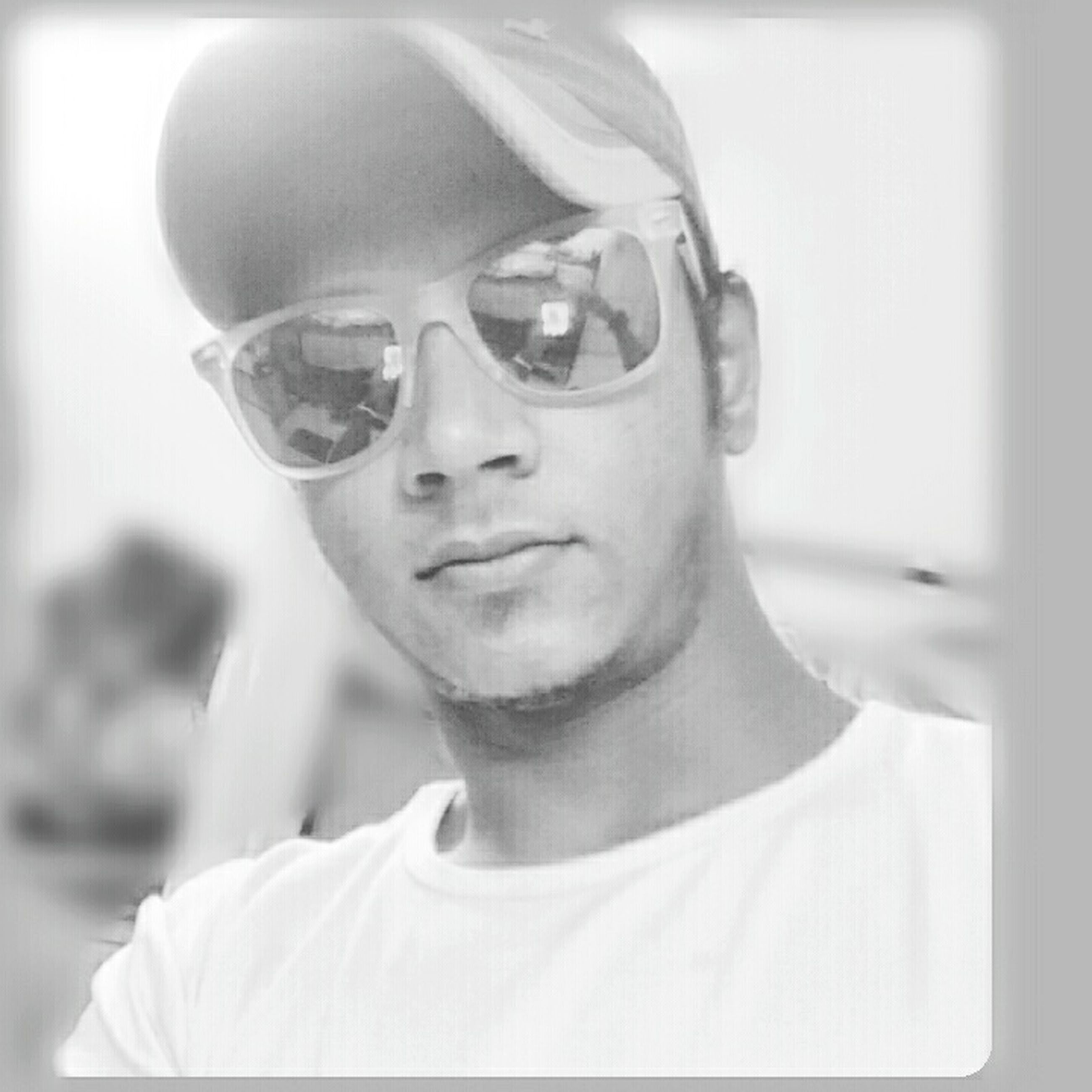 looking at camera, person, lifestyles, portrait, transfer print, leisure activity, headshot, front view, young adult, young men, indoors, casual clothing, auto post production filter, close-up, focus on foreground, sunglasses, head and shoulders, smiling