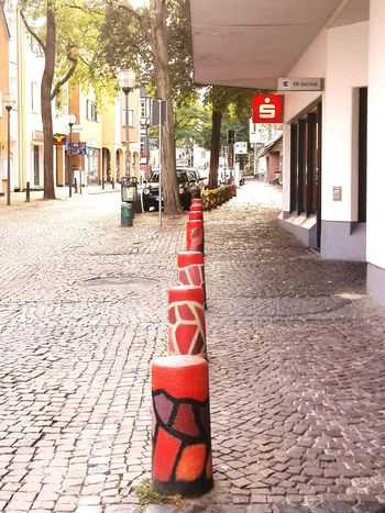 Kopfsteingepflaster Street Built Structure Transportation Architecture Road Building Exterior Pole The Way Forward Footpath Day Outdoors Pathway Long Red Paving Stone Town Narrow