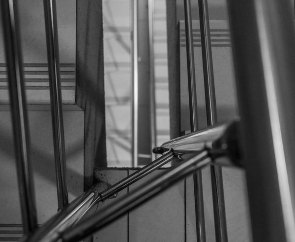 Street photos Railing Metal Staircase No People Steps And Staircases Indoors  Selective Focus Architecture Close-up Security Safety High Angle View Focus On Foreground Pattern Protection Home Interior Absence Day Building
