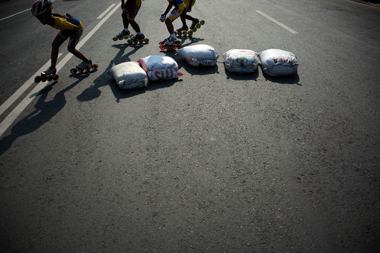 Skaters skating on street during race