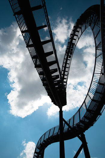 Low angle view of spiral staircase against sky
