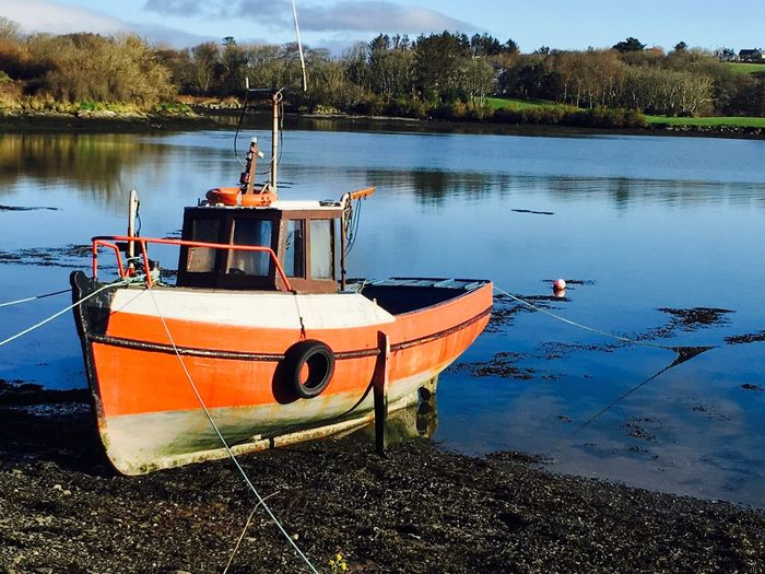 Irish fishing boat Fishing Boat Irish Fishing Boat Fishing Boats Fishing Boat On Beach Blue Sea Red Boat