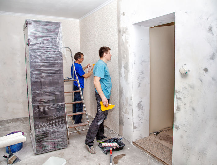 Male Workers Renovating Home