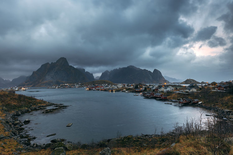 Reine is the administrative centre of Moskenes Municipality in Nordland county, Norway Cloud - Sky Sky Water Beauty In Nature Mountain Scenics - Nature Tranquility Tranquil Scene Nature No People Beach Land Sea Overcast Day Non-urban Scene Outdoors Idyllic Reine Lofoten Lofoten Moskenes Landscape Nordland