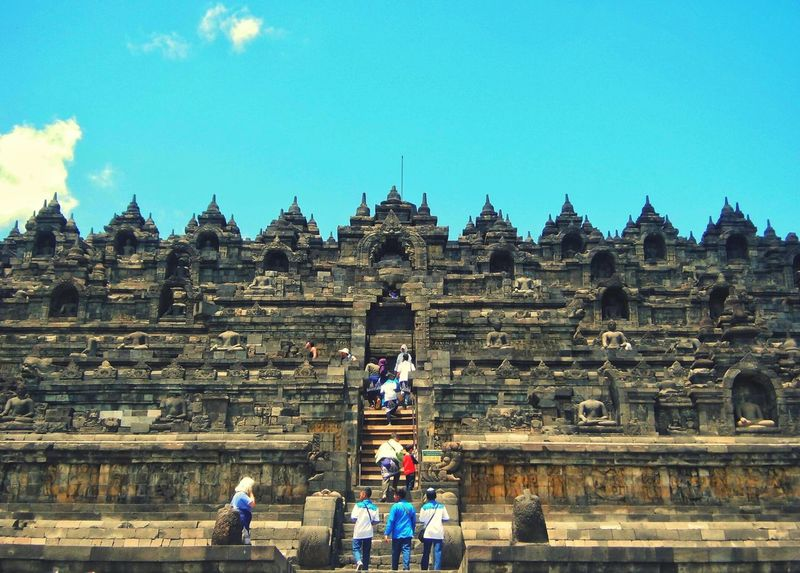 Candi Borobudur Indonesian Travelling Religion Travel Destinations Architecture Spirituality History Travel Ancient Tourism Place Of Worship Built Structure Large Group Of People Old Ruin Real People Men Sky Statue Day Ancient Civilization Outdoors Building Exterior