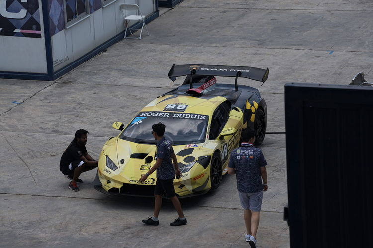 Super Car Maintenance in pit At the Motor Racing Festival Racetrack, Automobile Event Motorsport Racing Speedway Supermarket Teamwork Car ChampionshipBuryatia City Day Land Vehicle Luxury Men Mode Of Transportation Occupation Real People Speed Sports Super Car Transportation Vehicle