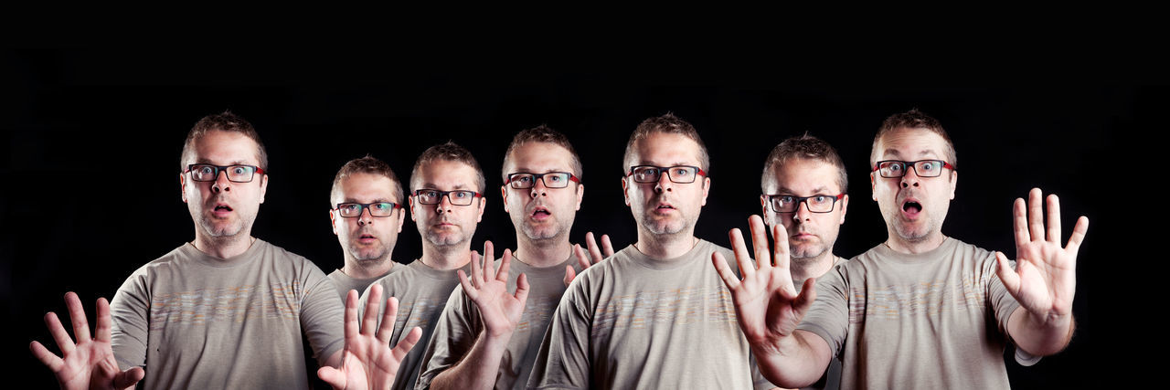 Multiple Image Of Man Gesturing Against Black Background