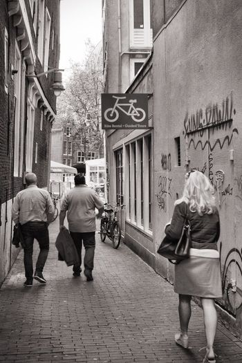 Building Exterior Built Structure Architecture Rear View Walking City Street Outdoors City Life Full Length Real People Men Casual Clothing Day Senior Adult Two People Lifestyles Women Pedestrian Adult 020 Amsterdam City City Walk