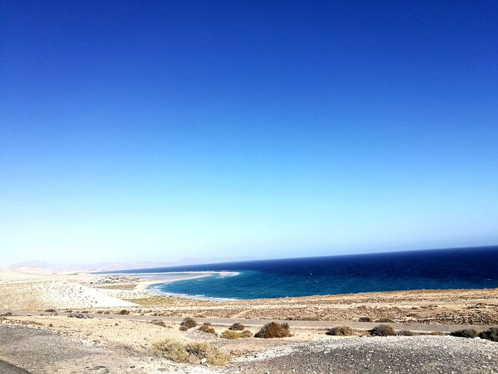 freedom Ocean Awsome Place Pacedeisensi Awesome Feel The Moment Nature Wild Coast Contemplation. Love The Sea Uncontaminated Nature Desert Landscape Water Sea Sand Dune Beach Sand Blue Desert Clear Sky Sky Horizon Over Water