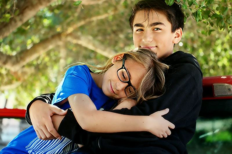 Midsection Of Two Embracing Teenagers