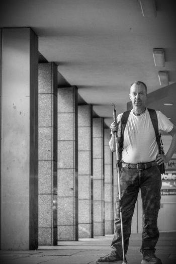 Full length of man standing in building