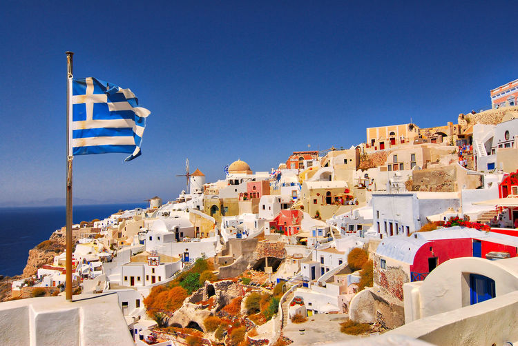 Greek flag against townscape