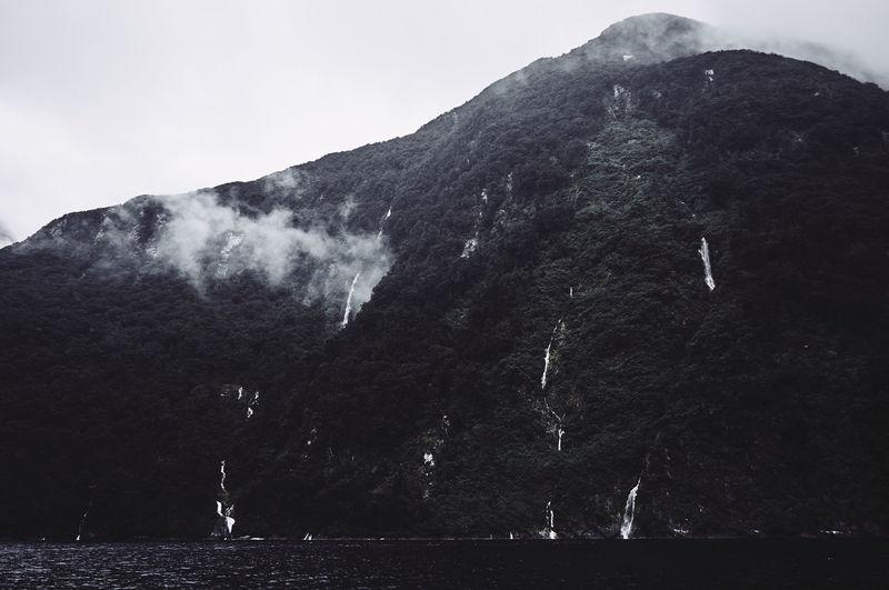 Sea Against Waterfalls On Mountain Sea At Te Anau