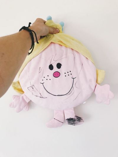One Person Hand Indoors  Human Hand Real People Human Body Part Women Childhood White Color Clothing Child Close-up Representation White Background Lifestyles Creativity Body Part Toy Pink Color