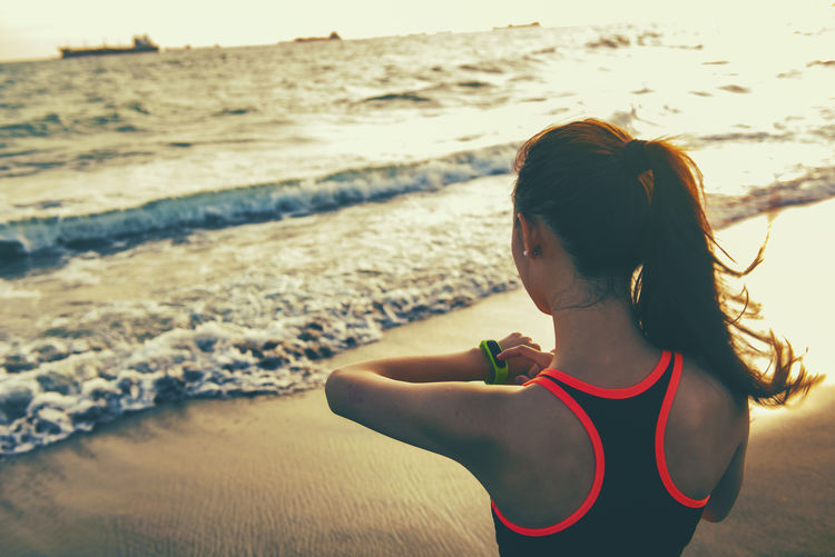 Life Beach Beauty In Nature Childhood Fit Fitness Focus On Foreground Girls Hair Hairstyle Land Leisure Activity Lifestyles Motion One Person Outdoors Real People Rear View Sea Sport Water Wave Women