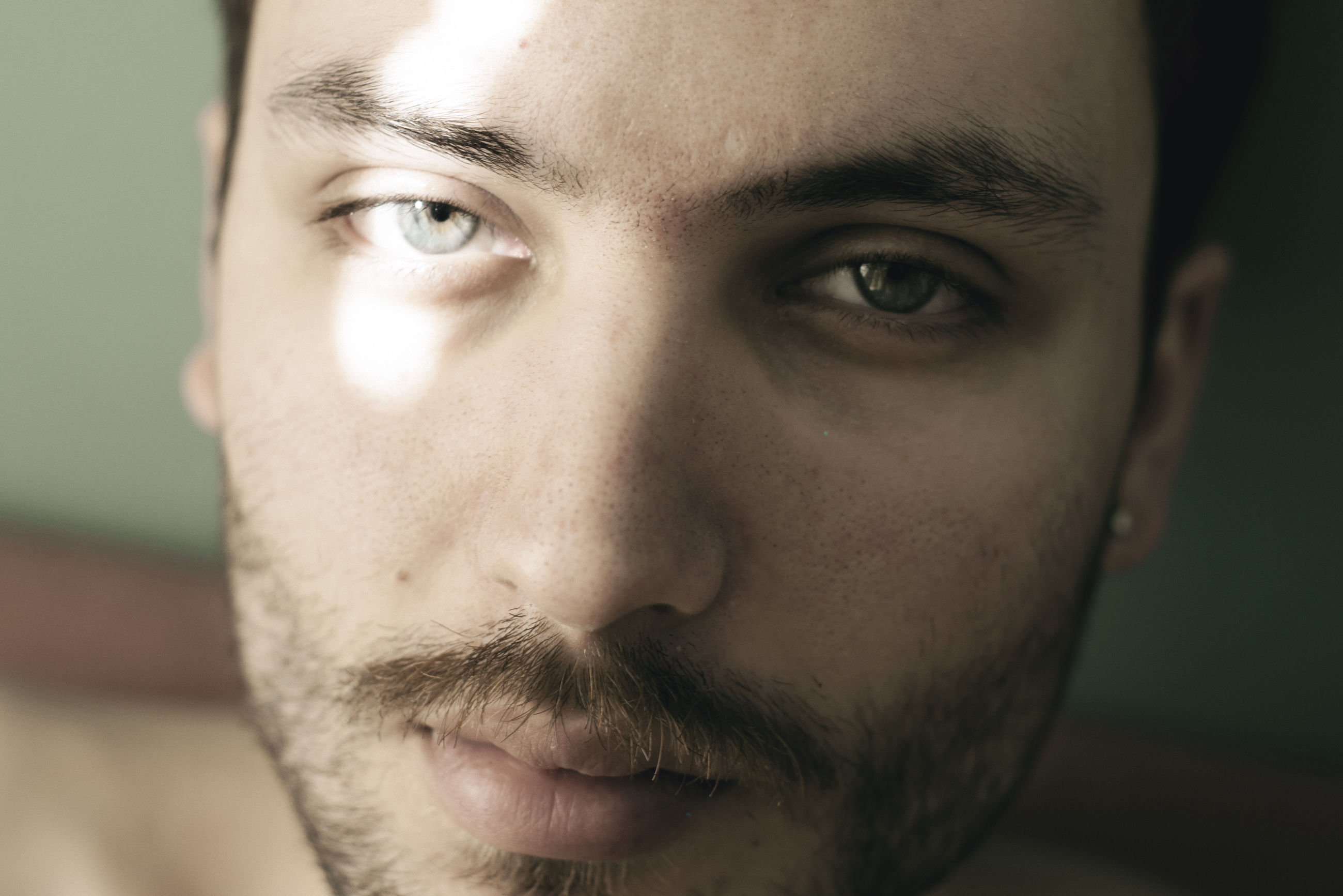 portrait, looking at camera, headshot, close-up, one person, young men, real people, men, young adult, beard, body part, human face, front view, human body part, focus on foreground, males, mid adult, facial hair, contemplation