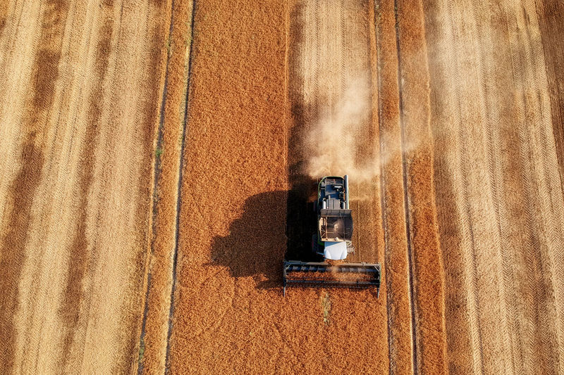 High angle view of combine harvester on field