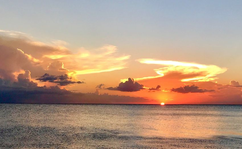 Sunset Sky Water Scenics - Nature Beauty In Nature Sea Cloud - Sky Tranquility Orange Color Tranquil Scene Horizon Over Water Horizon Beach Idyllic Nature Outdoors Sun