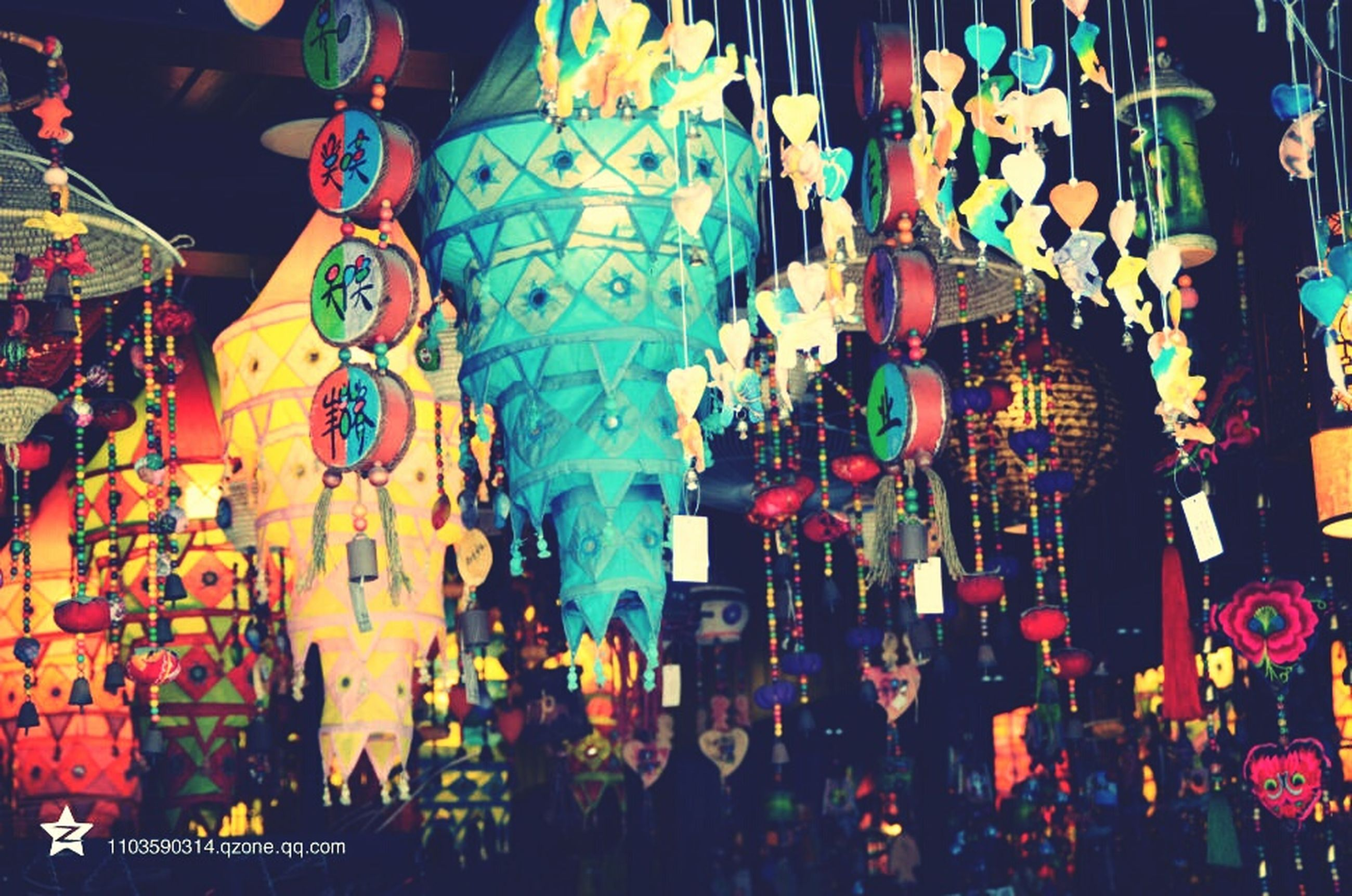 illuminated, hanging, indoors, retail, multi colored, art and craft, cultures, decoration, celebration, tradition, market, arts culture and entertainment, night, for sale, art, large group of people, human representation, creativity, market stall, store