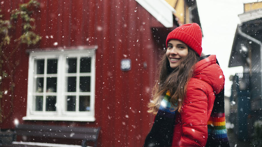 Portrait of smiling woman in snow