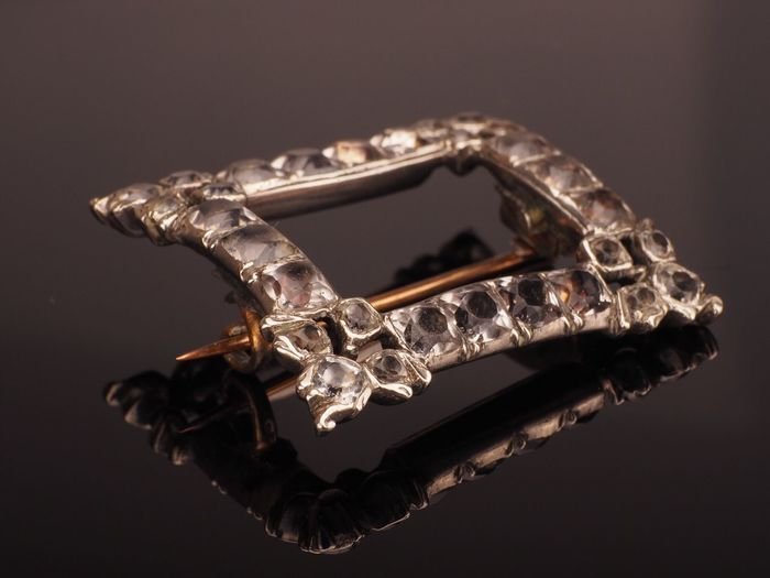 Close-up of brooch on table