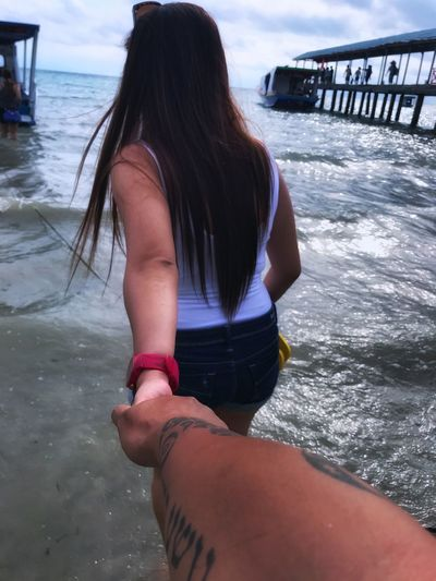 Love on my life.. Holding Hands Real People Water Sea One Person Lifestyles Leisure Activity Beach Rear View Wave Outdoors Beauty In Nature Women Young Adult Nature Love Yourself Inner Power