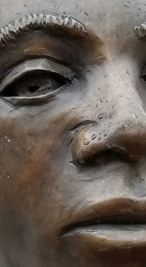Together we look forward to the future, with an eye on equality and our hearts riveted on justice. Close-up Human Skin Human Eye People Black History Sculpture Emotions Hope Emotion