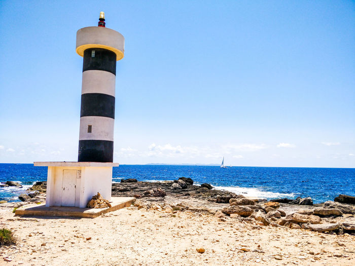 Water Sea Lighthouse Beach Nautical Vessel Blue Sand Sky Horizon Over Water Close-up Lookout Tower