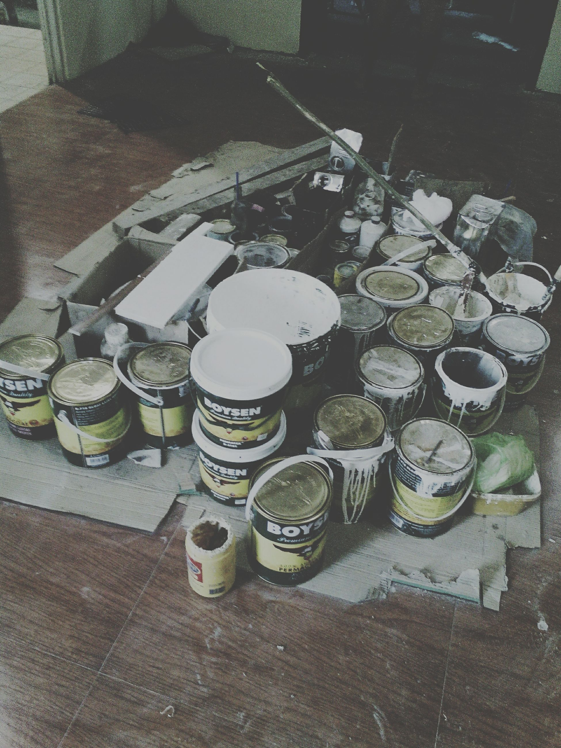 high angle view, still life, table, large group of objects, no people, container, day, abandoned, indoors, metal, arrangement, wood - material, stack, sunlight, old, bottle, absence, variation, abundance