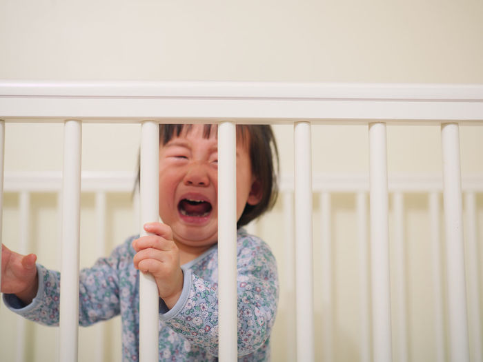 Boy In Crib Crying At Home