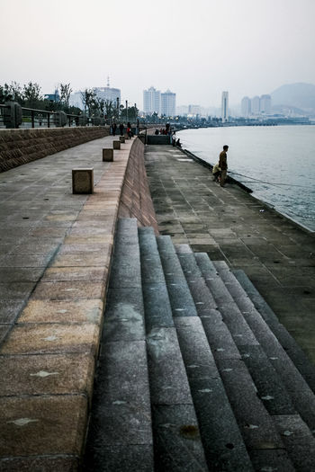 Absence Cobblestone Day Diminishing Perspective Distant Fishing Footpath Leading Narrow Outdoors Pattern Pavement Paving Stone Sea Seascape Seaside Shadow Sidewalk Stairway The Way Forward Walking Walkway Water Wood Wooden