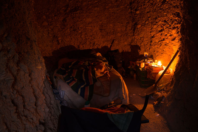 Granada, Spain SPAIN Andalusia Sacromonte Cave Real People Occupation People Night Fire Burning Men Fire - Natural Phenomenon Heat - Temperature Nature Skill  Indoors  Log Wall - Building Feature Working Firewood Illuminated Flame Architecture