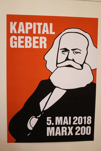 Postcards commemorating Marx's 200th birthday and the 150th anniversary of Marx's Capital with the text 'Kapitalgeber (capital investors) 5. Mai 2018 Marx 200' Das Kapital Marx Marxism Anniversary Capitalism Commemorate Commemorative Communication Karl Marx Portrait Red Representation Socialism Text