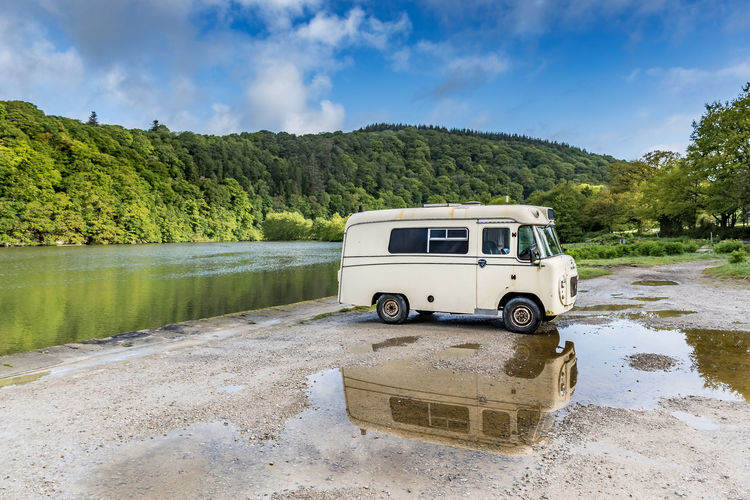 Nice place to relax and reflect Exploring EyeEm Best Shots Camper Van Reflection Reflections Reflections In The Water River Riverside River Tamar EyeEm Best Shots - Landscape Clouds And Sky Water Car Wet Sky Cloud - Sky Camping Motor Home Mini Van Van Van - Vehicle Sports Utility Vehicle Road Trip