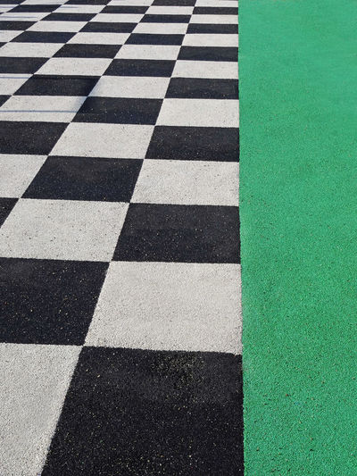 Checkerboard Pattern Alternation White Black Checker Board Green Band Sport Track Competition Playing Surface Car Sport Macadam Rough Texture Textured Surface Textured  Start Line Asphalt Competitive Sport Motorsport Tiled Floor Motor Racing Track Asphalted Asphaltography High Angle View Full Frame Backgrounds