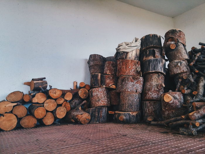 Stack of firewood on against wall