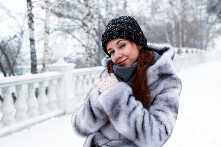 Portrait of beautiful woman in snow
