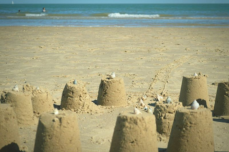 Sand Castles  Blurred Foreground Shell Shells🐚 Day At The Beach Beach Day Beach Sandy Beach Beach Photography Seaside British Seaside By The Sea Swimming In The Sea Sail Boat Sand & Sea Sea And Sky Blue Sky Not A Cloud In The Sky Sunny Day Frinton-on-Sea United Kingdom Nikon D3200