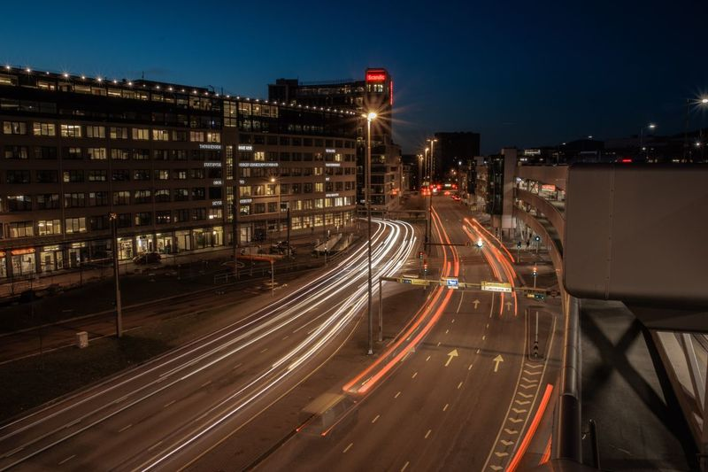 Illuminated Architecture City Building Exterior Built Structure Light Trail Night Motion Street Long Exposure Transportation City Life High Angle View Road Sign Nature Speed Sky Tail Light Building