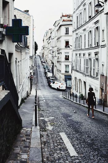 Montmartre neighborhood... Woman Walking On The Street Streetphotography Street Photography Paris, France  Montmartre Montmartre, Paris City Road Street Architecture Building Exterior Sky Built Structure The Traveler - 2018 EyeEm Awards The Street Photographer - 2018 EyeEm Awards Summer Road Tripping The Architect - 2018 EyeEm Awards Urban Fashion Jungle #urbanana: The Urban Playground Be Brave Summer In The City My Best Travel Photo A New Beginning This Is Natural Beauty