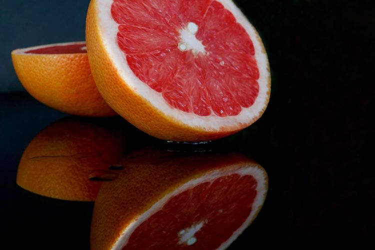 Appetite Black Background Citrus  Citrus Fruit Close-up Food Food And Drink Freshness Fruit Grapefruit Halved Healthy Healthy Eating Healthy Food Immunity In Two Indoors  Juice No People Pomelo
