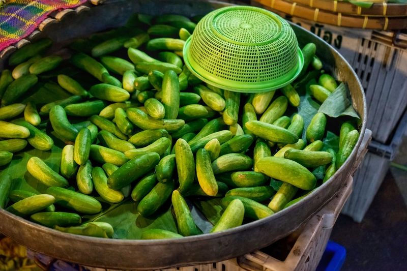 High angle view of fresh ivy gourd at market stall